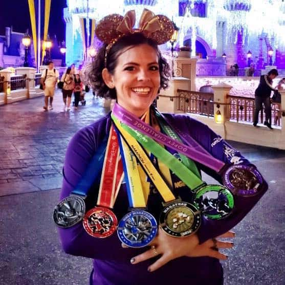 runDisney Dopey medals in front of Cinderella castle