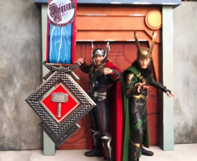 Thor and Loki with Thor 10K medal at Disneyland
