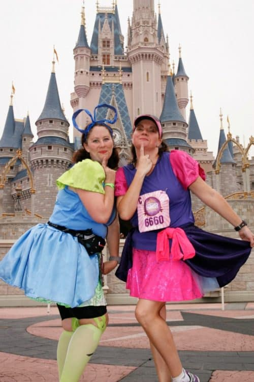 rundisney princess half marathon step sisters in front of the castle