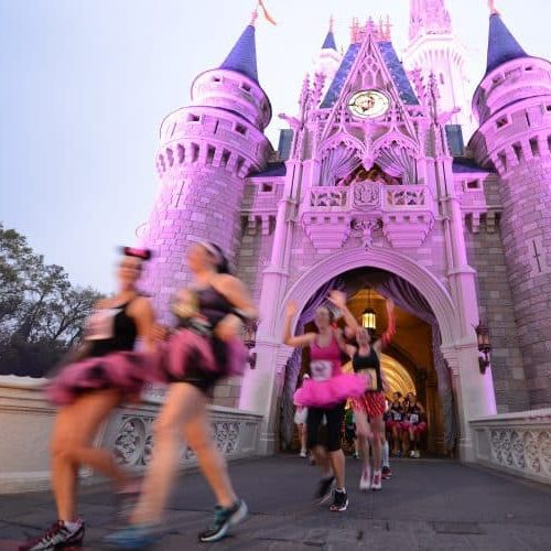 runDisney Princess half corrals, waivers, event guide girls running through the castle at Disney World