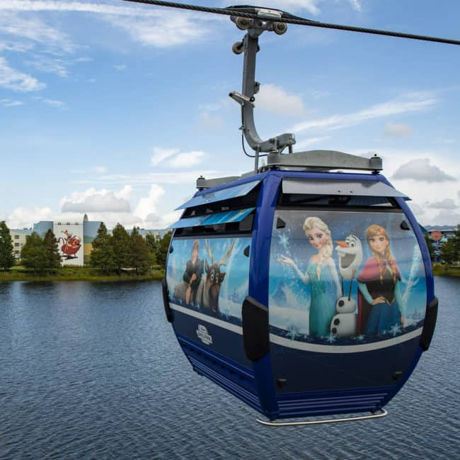 New Disney Skyliner cabin with Frozen characters on it and Art of Animation Resort in the background