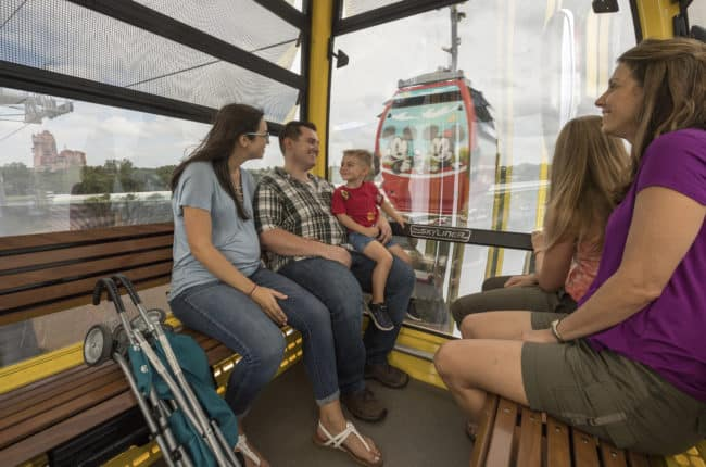 There's Magic in the Air with New Disney Skyliner inside view with adults and children