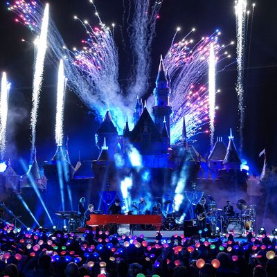 Elton John at Disneyland playing red piano in front of castle magical moment