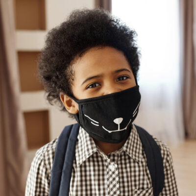 Little Boy Wearing a Face Mask going to Disney