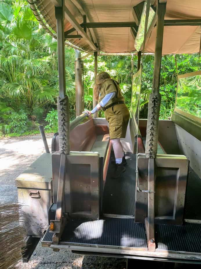 cleaning ride vehicles on the safari at animal kingdom