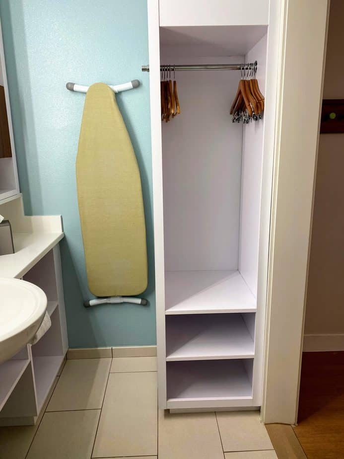 pop century bathroom ironing board and storage area
