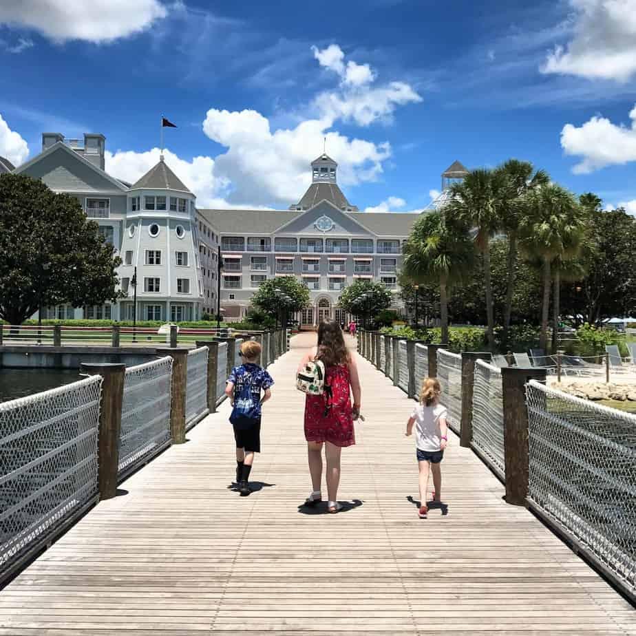 kids walking toward yacht club resort enjoying extra theme park hours at disney world